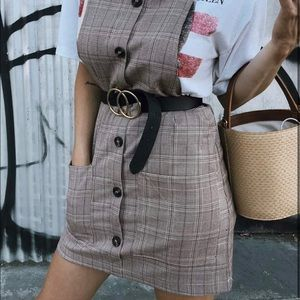 Plaid overall dress.